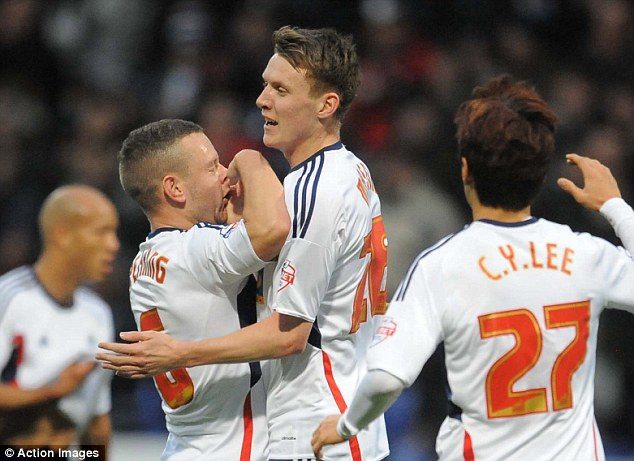 Loan star: Joe Mason (centre) scored his first goal for Bolton since joining on loan from Cardiff City
