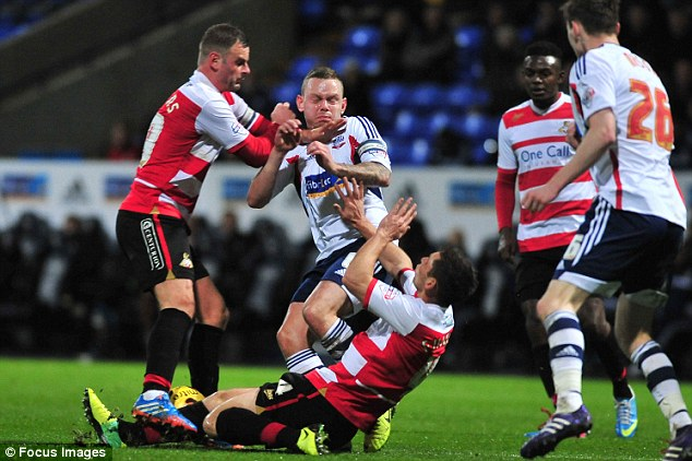 Getting stuck in: Boltons Jay Spearing enjoyed the middle battle against Doncaster