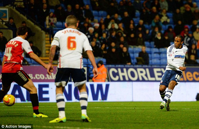 Third and final strike: Neil Danns (right) wrapped up the game in injury time with Bolton's third goal
