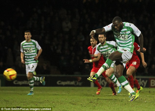 From the spot: Miller dispatches the penalty to draw Yeovil level after a spectacular comeback