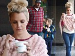 She's thinking pink...inside and out! While out with her boys, Britney Spears goes girlie by matching her trainers and poncho to her Pinkberry frozen snack