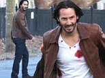 There will be blood: New pictures of Keanu Reeves on the set of John Wick shows the actor battered, bruised and covered in gore