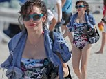 Hippie hippie shake! Rose McGowan displays her hourglass figure in a retro Woodstock-inspired swimsuit as she hits the beach in Miami