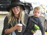 The ultimate juggling act! Hilary Duff has her hands full as she totes son Luca and an array of goodies during mother-son outing