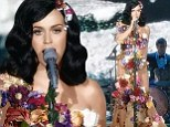 Blooming lovely! Katy Perry covers herself in flowers to protect her modesty in a sheer dress on Italian X Factor