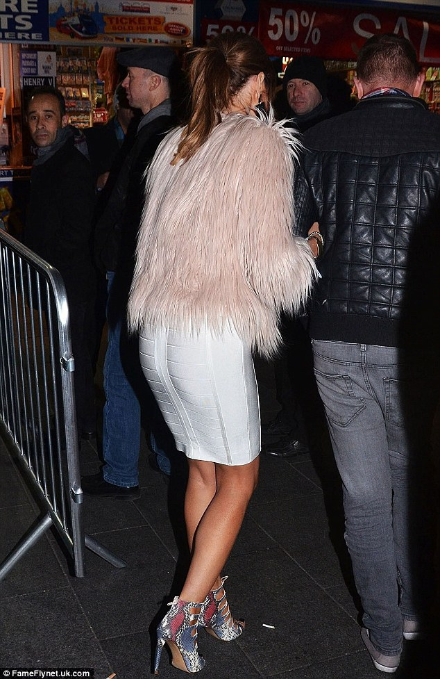 White on: Chloe Sims wore a figure enhancing frock as she parted in London on Thursday evening