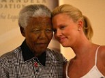 Tender: South African Oscar winner Charlize Theron shares a moment with Nelson Mandela on March 11, 2004, in Johannesburg, South Africa