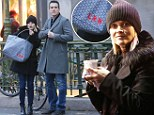 Reese Witherspoon totes her custom-monogrammed French purse through Paris alongside husband Jim Toth