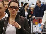 Amanda Bynes cuts a healthier figure as she continues to stay under the watchful eye of her parents during shopping trip after being released from rehab