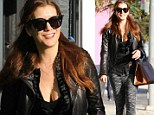 Is there a doctor in the house? Kate Walsh makes a few hearts skip a beat going shopping in a low cut sheer top