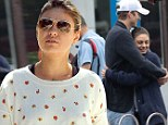 Could she be next? A radiant Mila Kunis attends her brother Michael's romantic wedding in Florida with Ashton Kutcher