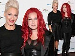 Pink and Cyndi Lauper pose with their wacky hairstyles
