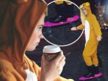 Furry nice! Ireland Baldwin snuggles up with a cub-sized coffee and bear onesie during drive after jumping on her skateboard in playful suit
