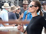 Taking charge! Angelina Jolie commands the rapt attention of her crew as she returns to Unbroken set after family fun weekend