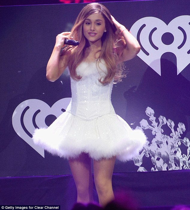 All white on the night: Ariana completed her cute ensemble by wearing her long light brunette locks tumbling in loose waves around her shoulders and opted for natural make-up to accentuate her striking features
