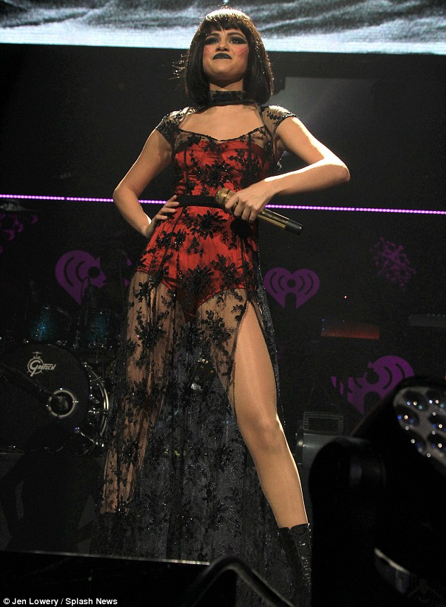 Is that you, Selena? Selena Gomez was practically unrecognisable in a vampy black wig and sexy thigh-split dress