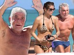 No wonder he's so happy! Roberto Cavalli, 73, waves exuberantly as he bares (almost) all in yet another sunbathing session with much younger model girlfriend