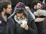 Aaron Taylor-Johnson, 23, keeps wife Sam, 46, warm as he visits her on the set of 50 Shades Of Grey in chilly Vancouver
