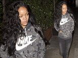 Going with the flow! Makeup free Rihanna debuts her new cascading new curly weave as she dines at her favourite restaurant