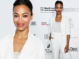 Blooming lovely! Zoe Saldana plays blushing bride in a white designer pant suit and lacy camisole at Miami Beach bash