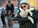 My sweet girl! Gisele Bundchen cradles her baby Vivian on trip to the park in blistery Boston with Tom Brady and their brood