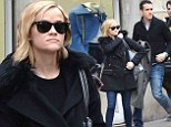 The couple that dresses together... Reese Witherspoon and Jim Toth arrive in Paris in matching denim trousers and jackets