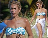 Hot momma! Hoda Kotb displayed her toned bikini body on the beach in Miami, Florida on Saturday