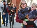 They're tight! Hilary Duff sports super snug skinny jeans as she enjoys a day of family bonding with her husband and son