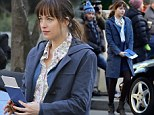Dakota Johnson looks pensive and slightly overwhelmed after her first meeting with Christian on set of Fifty Shades Of Grey
