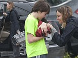 Calista Flockhart and son collect puppy