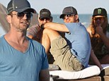 But where are the girls? Notorious ladies man Gerard Butler enjoys a rare day on Miami beach with just the boys
