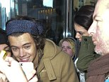 That grin says it all! A very happy Harry Styles emerge from hotel with Kendall Jenner after 'new couple' are reunited in New York