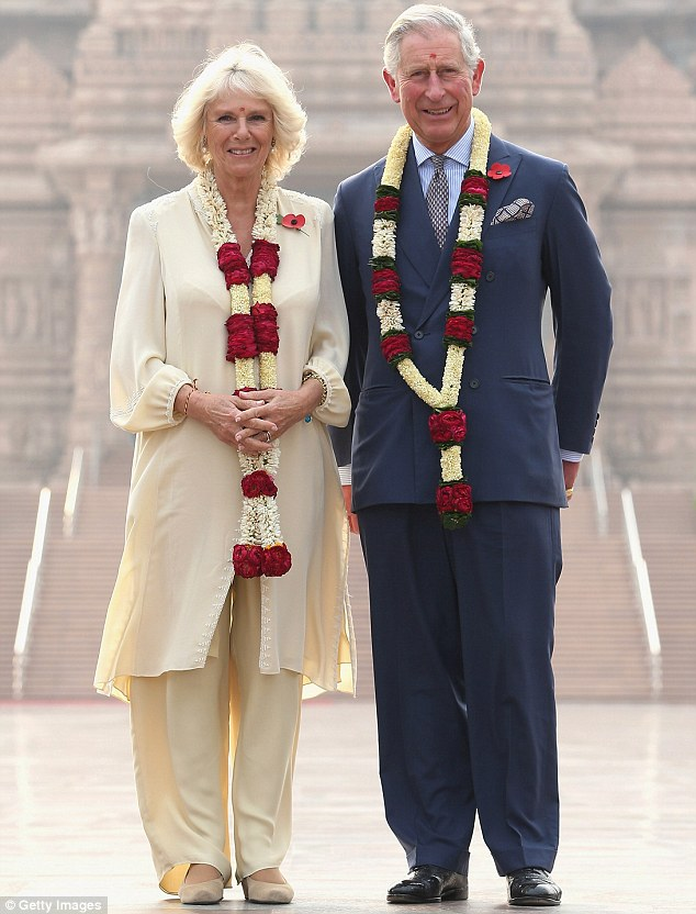 Happy: Camilla, Duchess of Cornwall and Prince Charles, Prince of Wales pose outside the Akshardham Temple during day 3 of an official visit to India earlier this month. Camilla has brought out the best in her husband