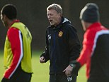 Making his point: David Moyes shouts instructions to his players on a quiet morning at Carrington