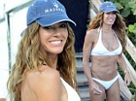 Kelly Bensimon takes her love of the gym too far as she displays her VERY hard body in a white bikini