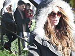Pregnant Megan Fox hides her baby bump beneath snug winter coat on family outing with Brian Austin Green and little Noah