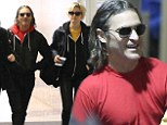 You've got to be Joaq-ing: Hollywood star Joaquin Phoenix and young girlfriend Allie Teilz wearing matching outfits to LAX
