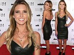 Ultra-slim Audrina Patridge flaunts cleavage in black leather mini-dress at Las Vegas bash