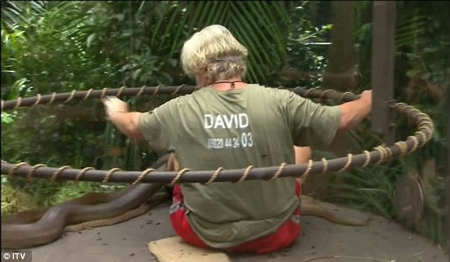 Up close and personal: David is faced with a large snake as he takes part in the task