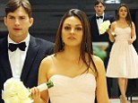 Will they be next? Mila Kunis stuns in a pale pink dress as she acts as bridesmaid at brother Michael's wedding with a dapper Ashton Kutcher by her side