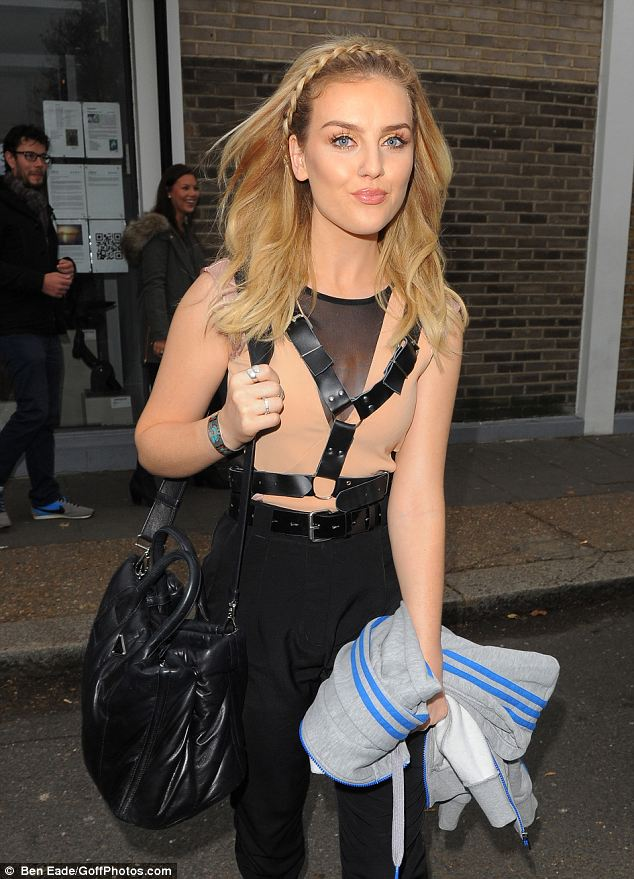 Bondage look: Perrie Edwards of Little Mix steps out in a leather harness and a nude-coloured top