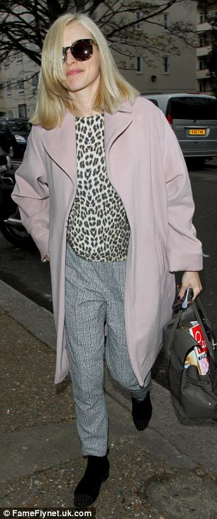 Super stylish: Fearne Cotton stepped out in a warm rose pink coat, jeans and a leopard-print top