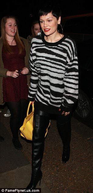 Going wild: Jessie J rocked a zebra-print jumper and a bright yellow tote bag