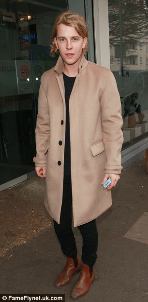 Classic look: Tom Odell opted for a cosy camel-coloured coat