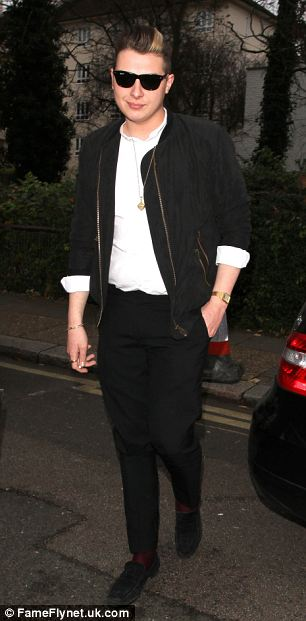 Classic look: Tom Odell opted for a cosy camel-coloured coat while John Newman went for a monochrome ensemble