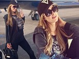 'I travel way too much!' Paris Hilton laments her 'jet-set' life as she poses in a private plane on her way home from Miami