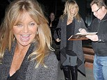 Made his day: Gorgeous Goldie Hawn signs an autograph for a fan outside a Brentwood restaurant Sunday