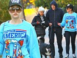 With her every step of the way! Amanda Bynes continues down the road to recovery as she walks the family dogs with her parents