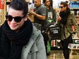 Glee star Lea Michele keeps a chin up in woolly scarf and green jacket on solo grocery run as she faces holiday season without Cory Monteith