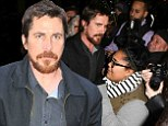 The perfect swarm! Christian Bale mobbed by fans as he steps out in New York to promote American Hustle